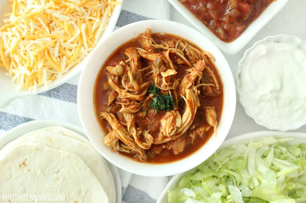 If you are looking for a crockpot chicken taco recipe, these crockpot shredded chicken tacos are super easy, and out of this world good!