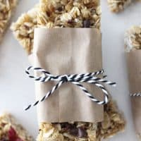 homemade granola bars stacked on each other wrapped in paper and twine