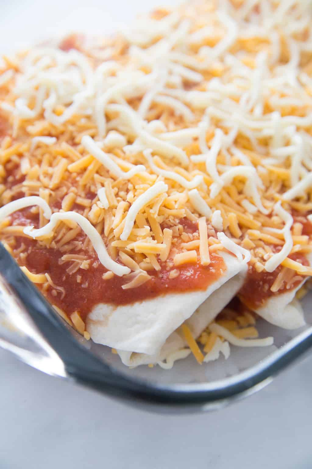 beef enchiladas in pan ready to freeze