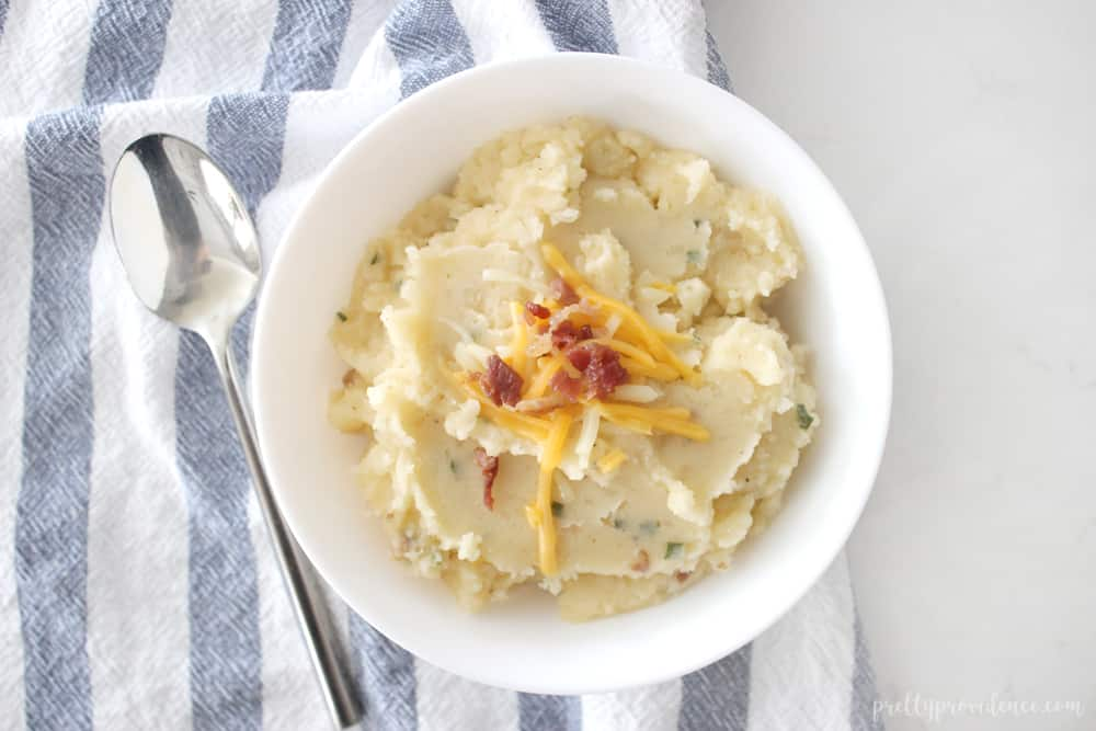 Loaded Crock Pot Mashed potatoes are the PERFECT side to bring to any pot luck gathering! So easy and so GOOD!