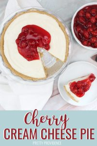 Cherry Cream Cheese Pie, one slide on a white plate, with cherry pie filling in a bowl on the side.