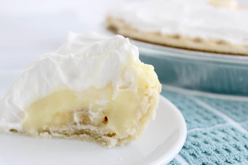 banana cream pie with a slice missing