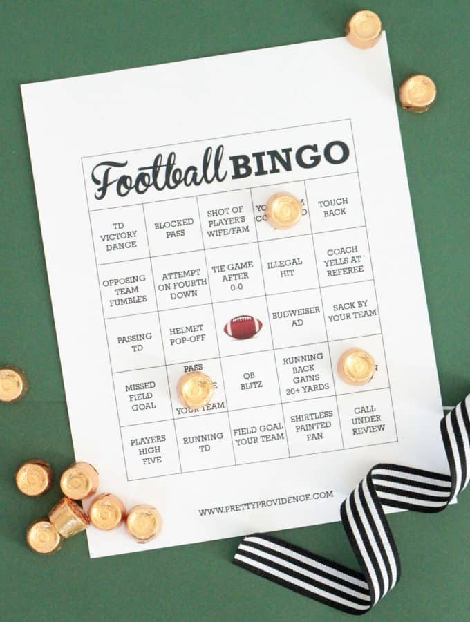 White football bingo card with black text, rolo candy as markers on a green background.