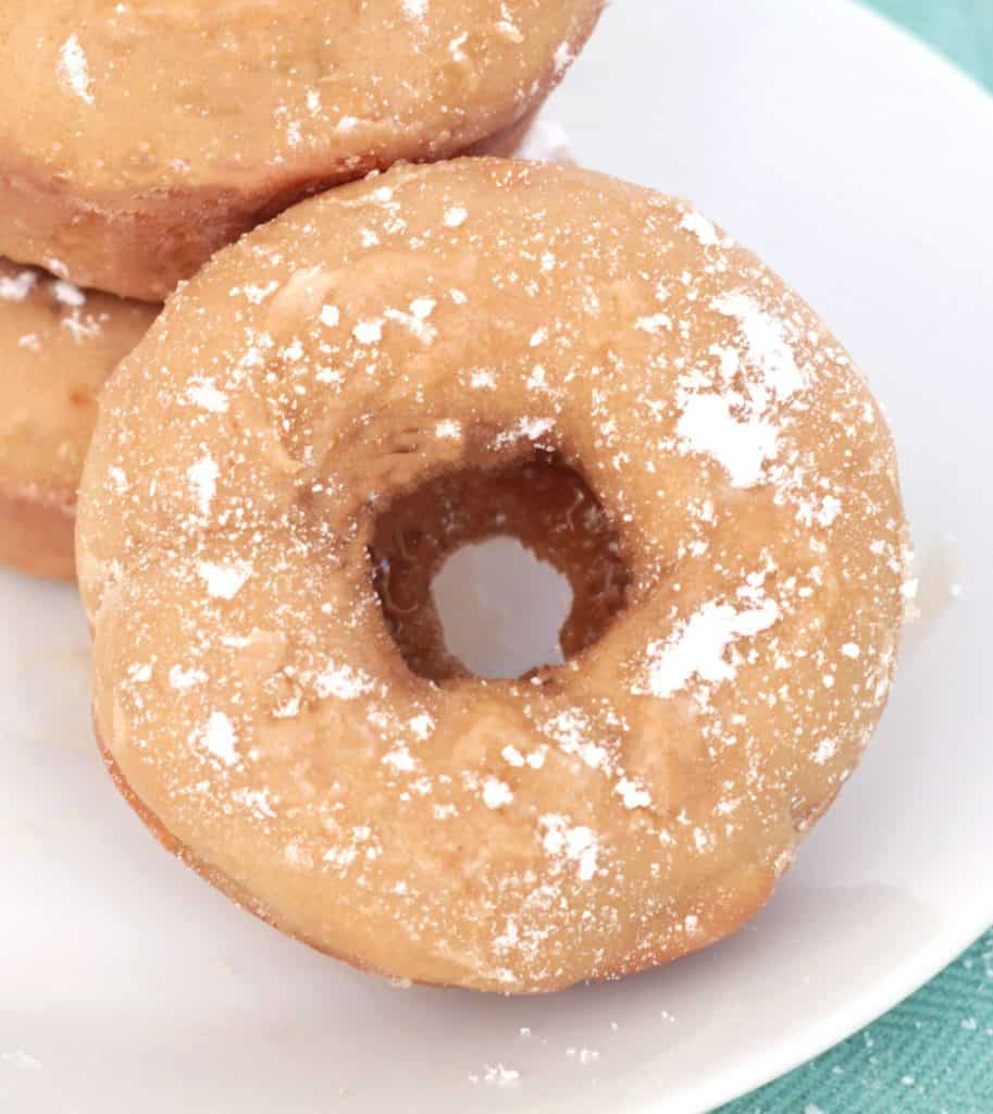 Cookie Butter Cake Donut with powdered sugar dusted on top.