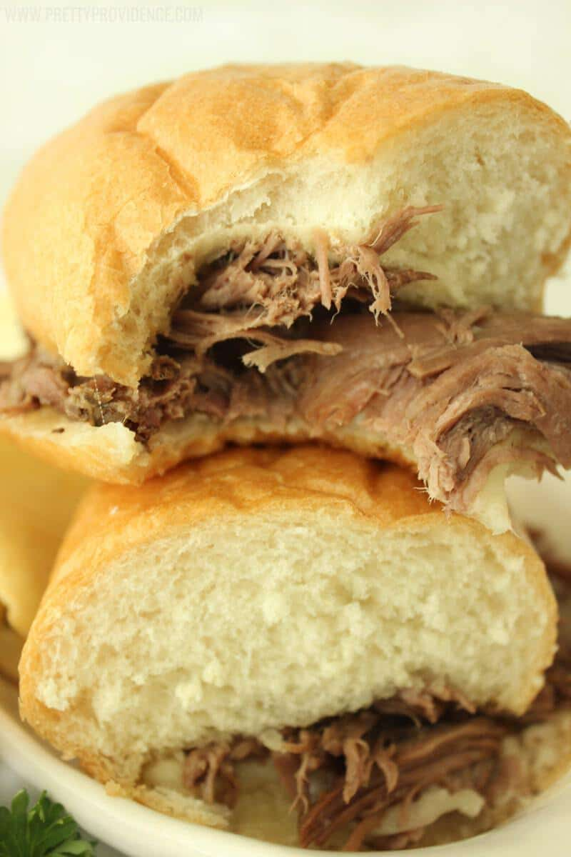 Add roast, beef consomme and Italian dressing to the crock pot and cook on low for 8 hours, or until meat shreds easily with a fork. After your meat is cooked and shredded, butter your buns and broil them in the oven for a couple of minutes.
