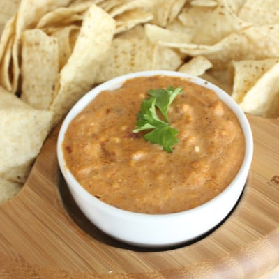 This cheesy crock pot bean dip is AMAZING!! Definitely my go-to recipe for any party or gathering-- a total crowd pleaser!