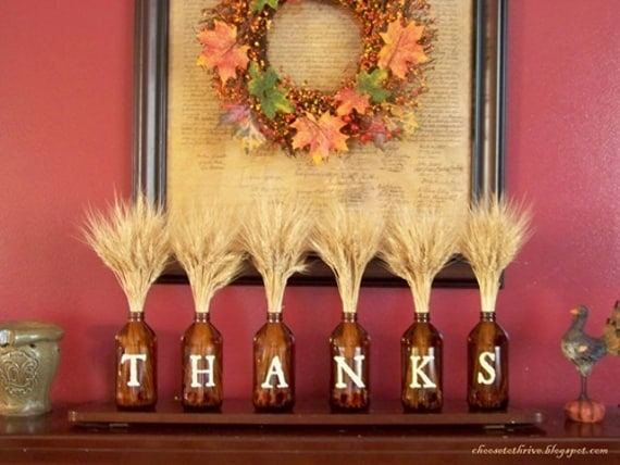 thanksgiving decor idea, jars tha spell out T H A N K S on a mantel with wheat coming out of the jars.