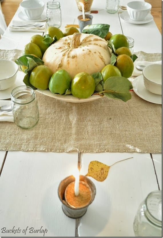 thanksgiving centerpiece: pumpkin and persimmons in a large bowl! simple and gorgeous
