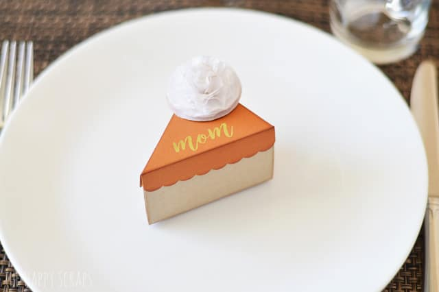 Mini Pie Box place card made out of card stock for Thanksgiving on a white plate.
