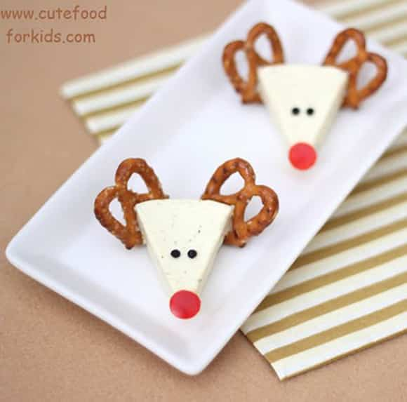 Reindeer Cheese snack with cheese wedge, pretzel antlers and red nose