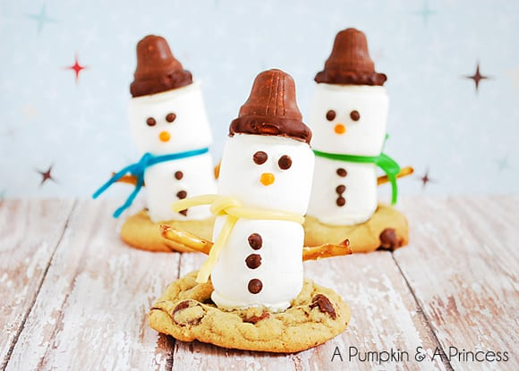 Marshmallow Snowmen on top of chocolate chip cookies