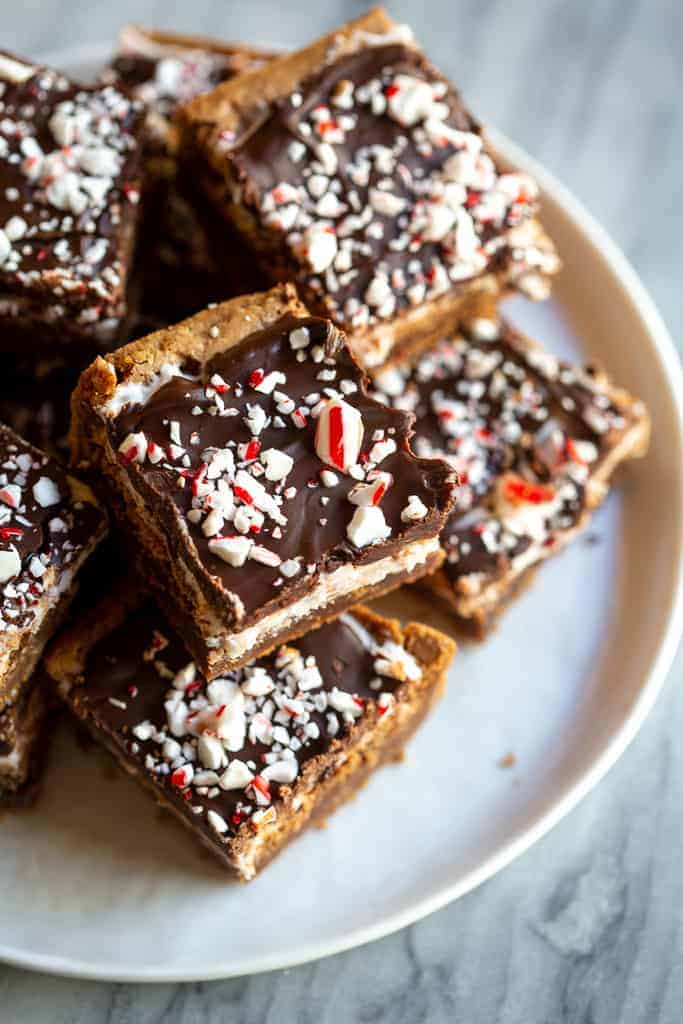 Peppermint Brownies with Chocolate Frosting and crushed candy canes on top