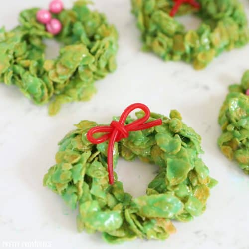 Christmas cornflake wreaths marshmallow treats with red licorice bows and candies
