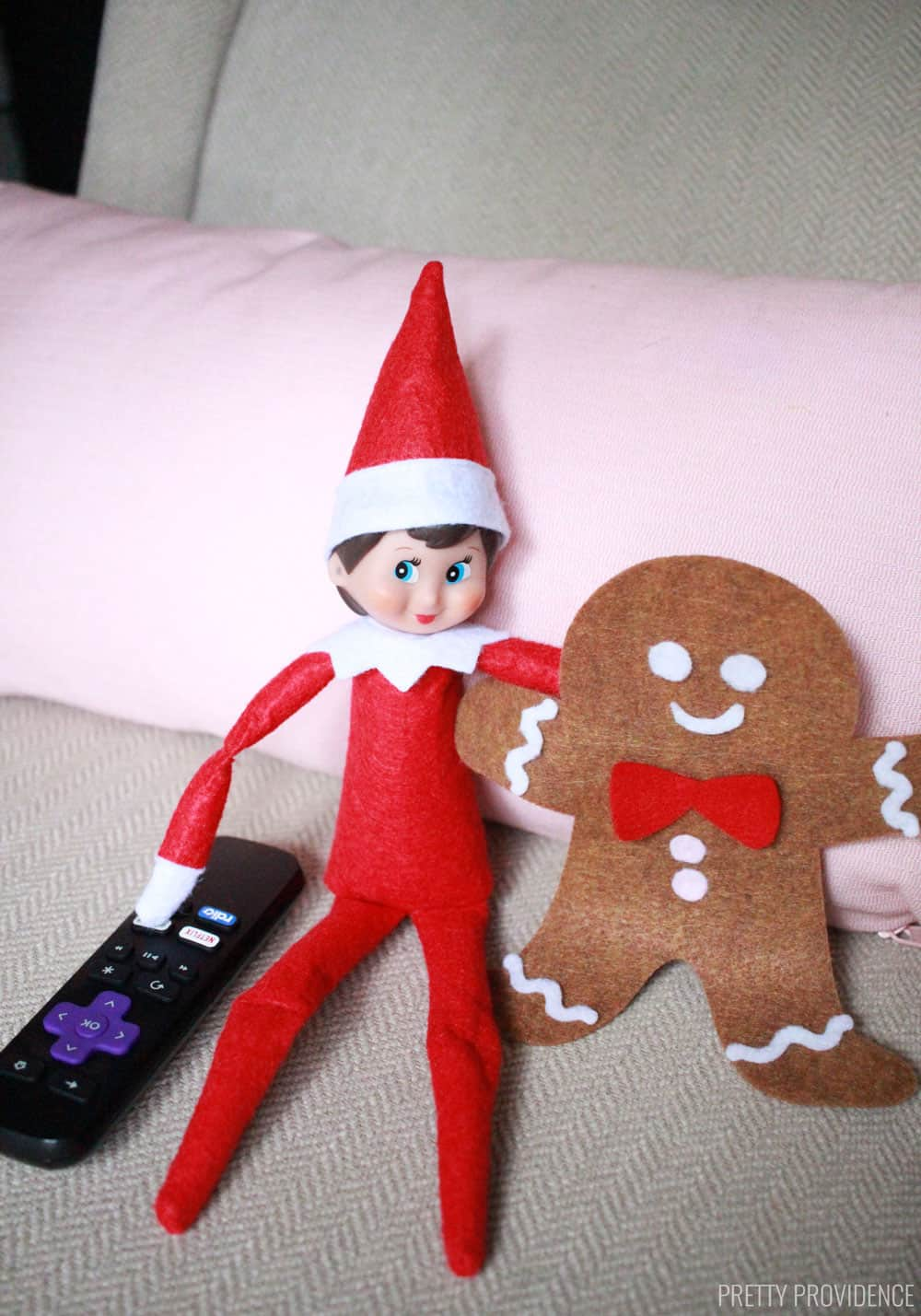 Elf on the Shelf watching tv
