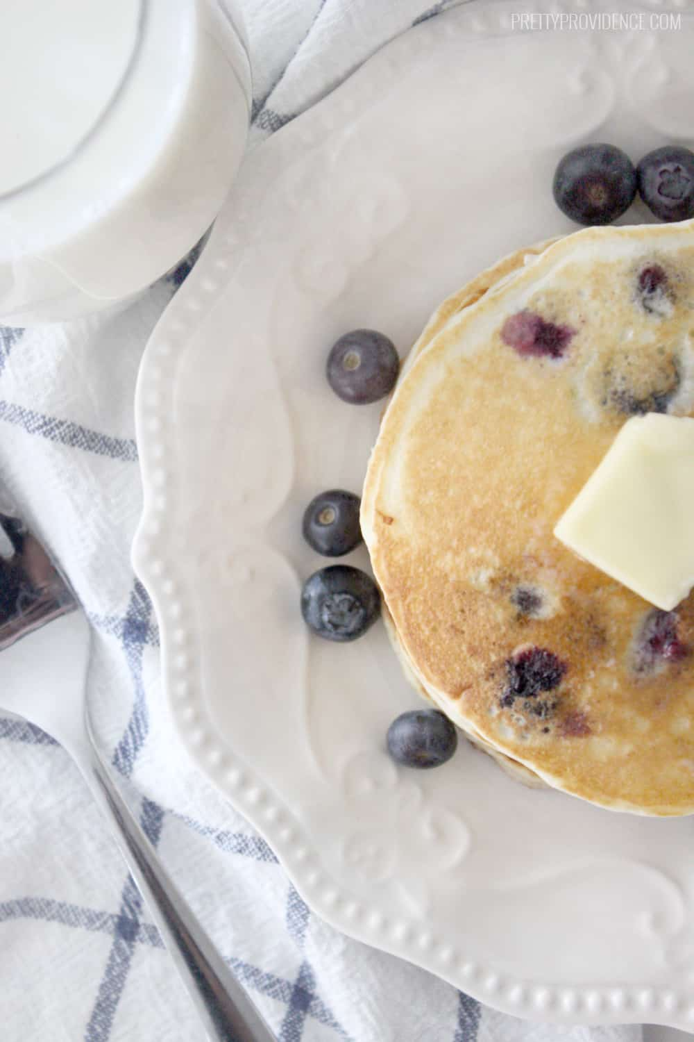The BEST blueberry pancakes with blueberry syrup you will ever eat in your life! Seriously restaurant quality delicious!