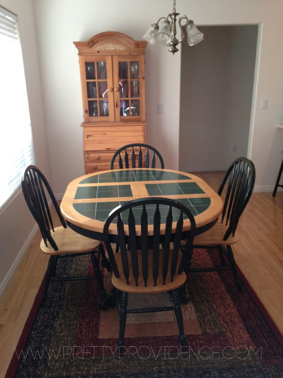 Oak and green tile tabletop, with matching dining chairs in a kitchen.