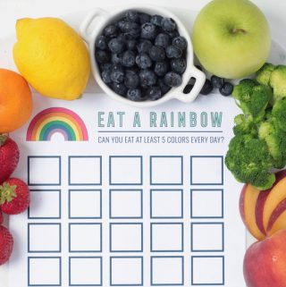 Reward chart printable for eating healthy - 'Eat A Rainbow' with fresh fruit and vegetables surrounding the paper.