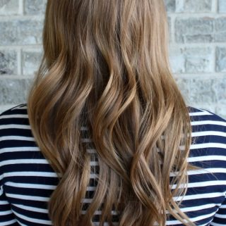 the case for growing out your hair: save hundreds of dollars a year on trims and other maintenance!