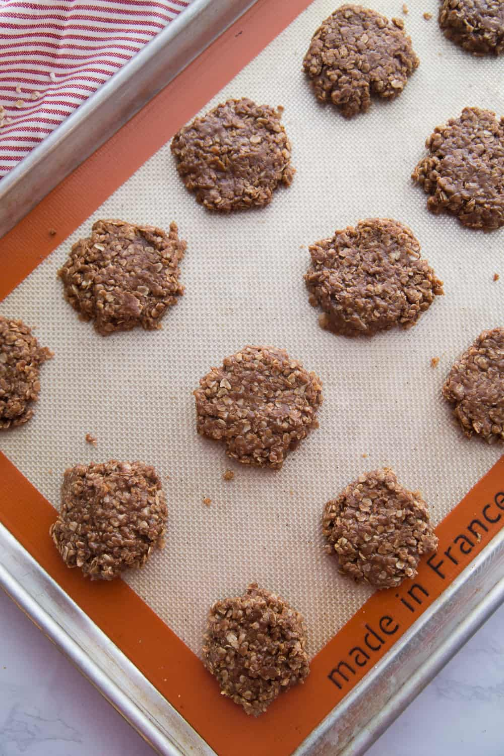 No bake cookies lined up on a cookie sheet.