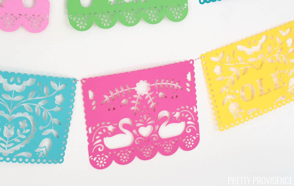 Papel Picado made from colorful card stock against a white wall