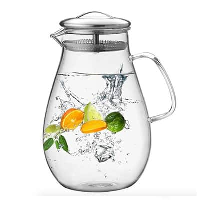 Glass Pitcher with citrus fruit and water in it.