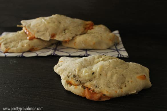 Easy and delicious homemade pizza pockets! My mom made these all the time growing up and now my family loves them!