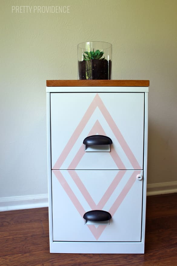Filing cabinet makeover! A little paint and some new hardware make this a beauty instead of a boring eyesore!