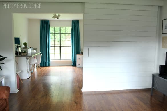 DIY Sliding Barn Door - modern way to add a door to your house!