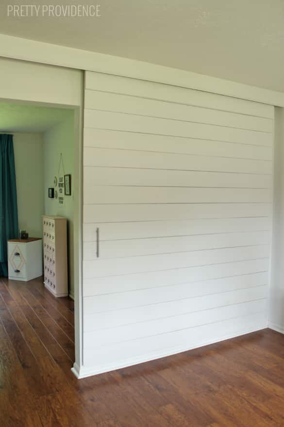 DIY Sliding Barn Door - this is actually an affordable way to do this!