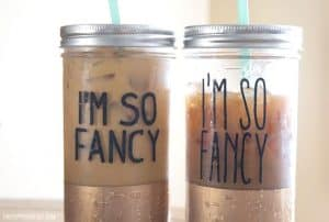 Two mason jar tumblers with black vinyl decals 'I'm so fancy' iced coffee