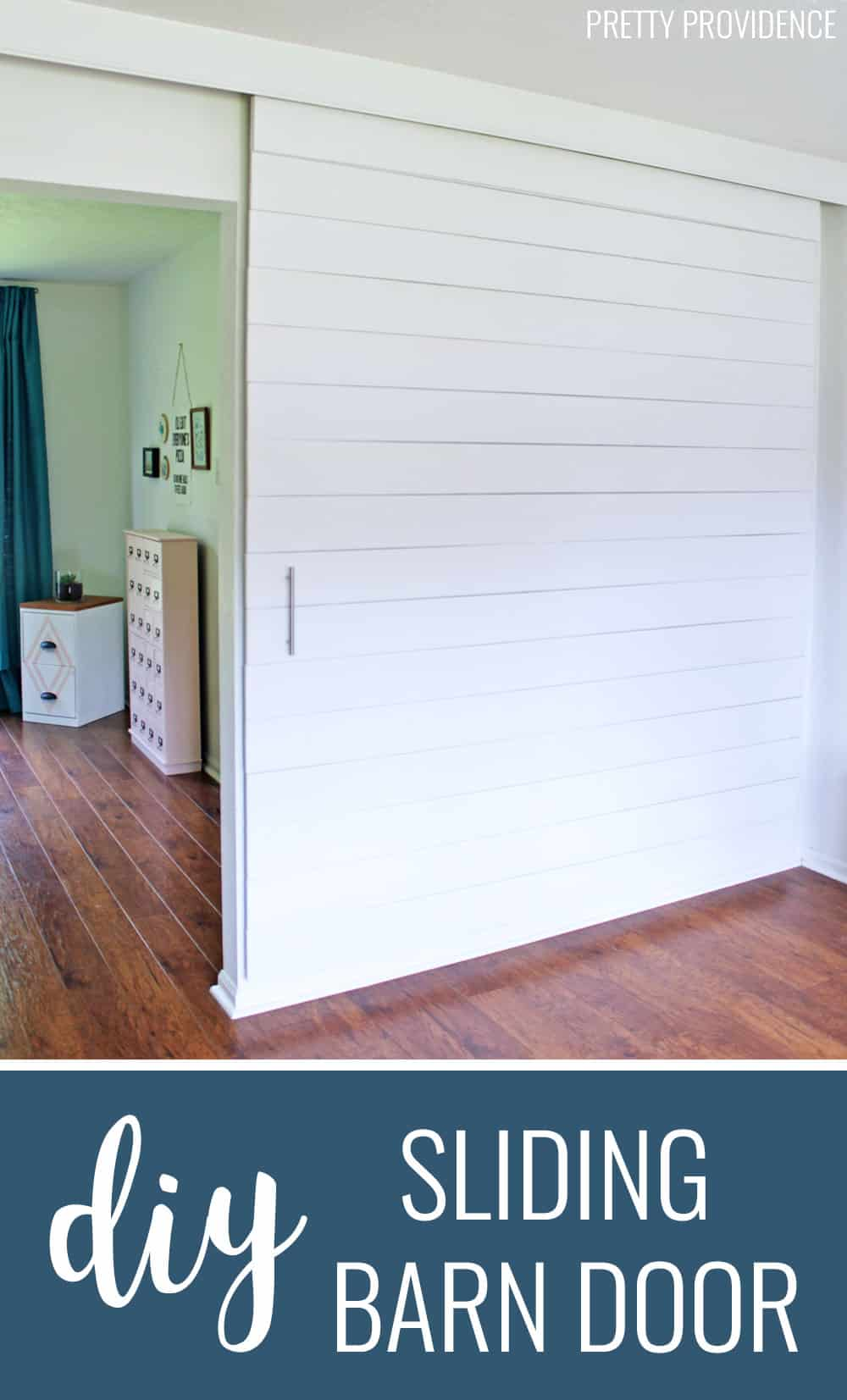 This DIY sliding barn door painted white is perfect DIY project for modern and farmhouse decor!