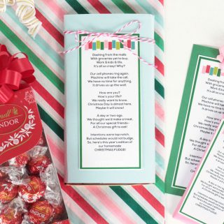 Lindor Milk Choocoate truffles, homemade christmas fudge poem printable gift tag and wrapping paper on a white surface.