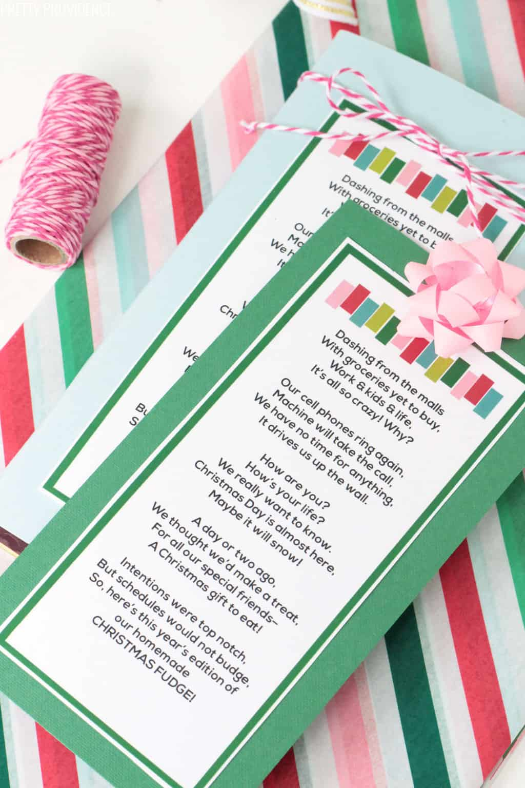 Homemade Christmas fudge neighbor gift idea with free gift tag on top, pink bow on top.