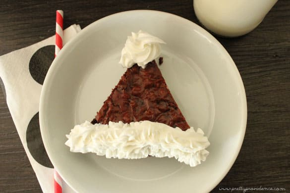 My kids were obsessed with these Santa Hat red velvet brownies.. and they were so easy it felt like cheating!