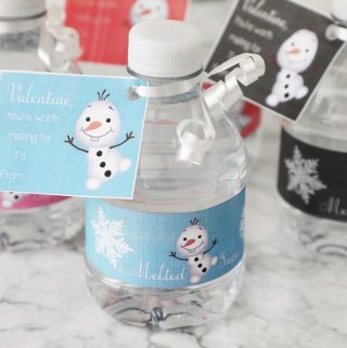 Mini water bottle with free printable frozen valentine attached with white ribbon