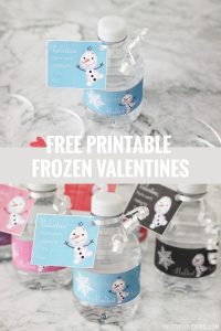 mini water bottles with frozen printable labels on a marble countertop