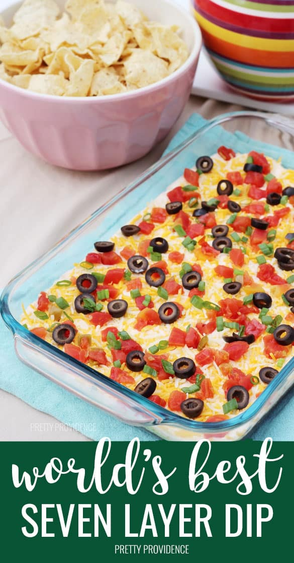 The absolute best 7 layer bean dip recipe! This recipe has a secret ingredient that takes this dip over the top. It's AMAZING and always a crowd-pleaser. #sevenlayerbeandip #7layerbeandip #7layerdip #layerdip #mexican #appetizer #recipes #easyrecipe #easyfoodrecipe #beandip #gameday #superbowl #snack #appetizerideas #appetizer #tacodip