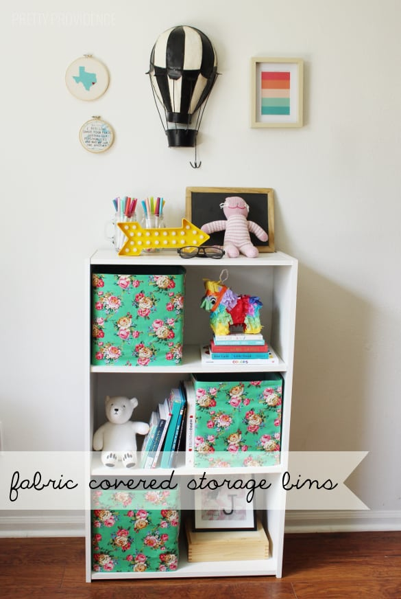 Cover cheap storage bins with pretty fabric! THIS IS GENIUS!