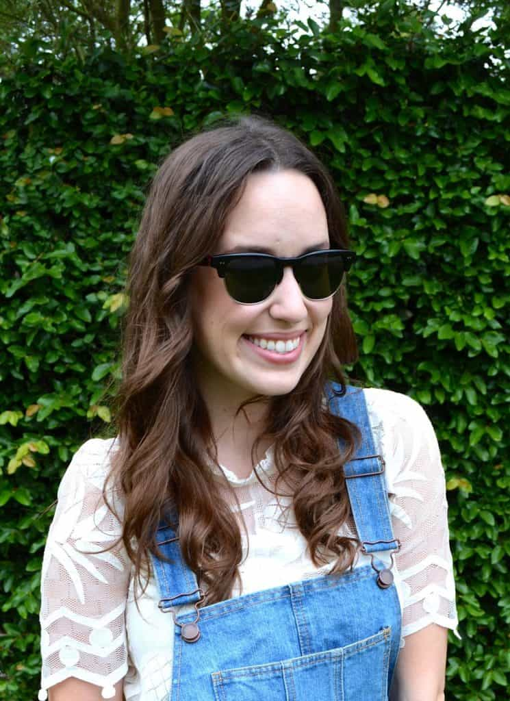 Trendy overalls with a delicate white lace top.
