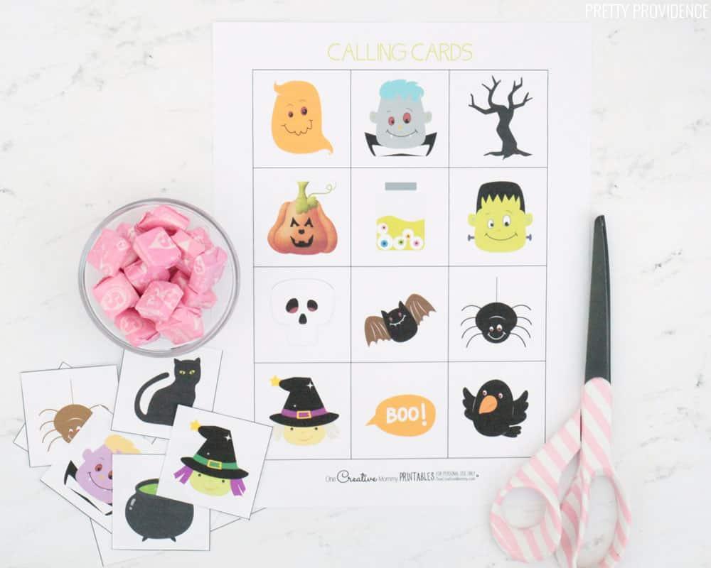 Halloween Bingo Calling Cards, scissors and pink starburst.