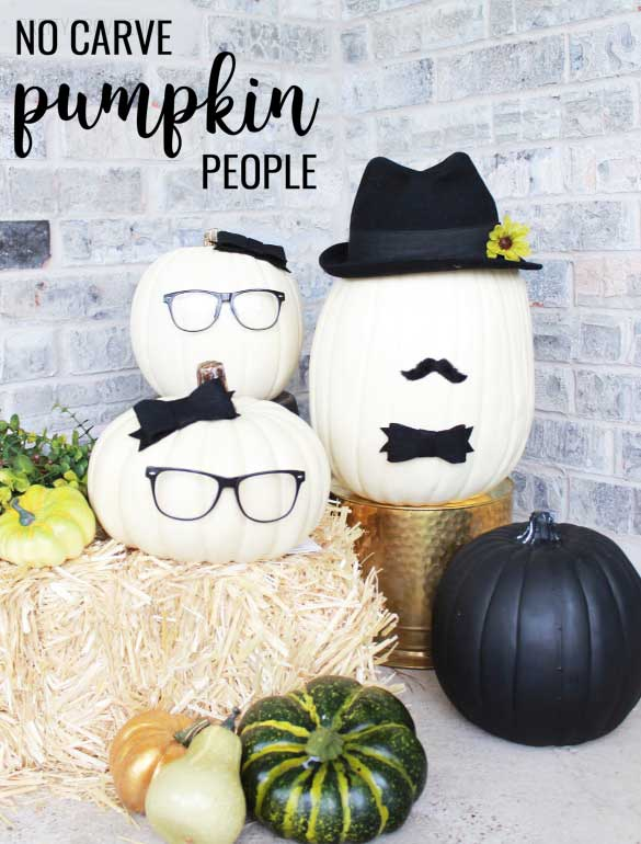 No-Carve Pumpkins decorated to look like people with glasses, bows, mustache and hats.