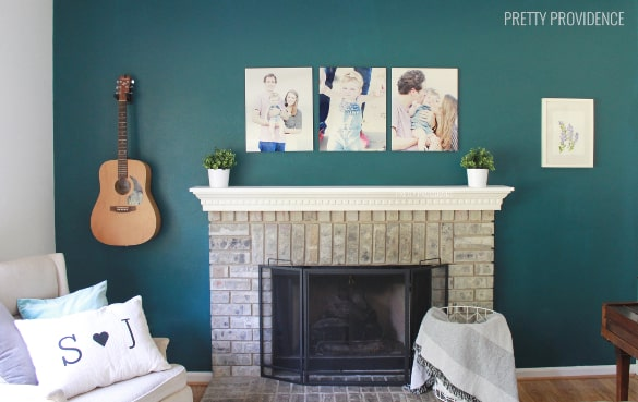 LOVE THIS! three metal prints over the fireplace | prettyprovidence.com