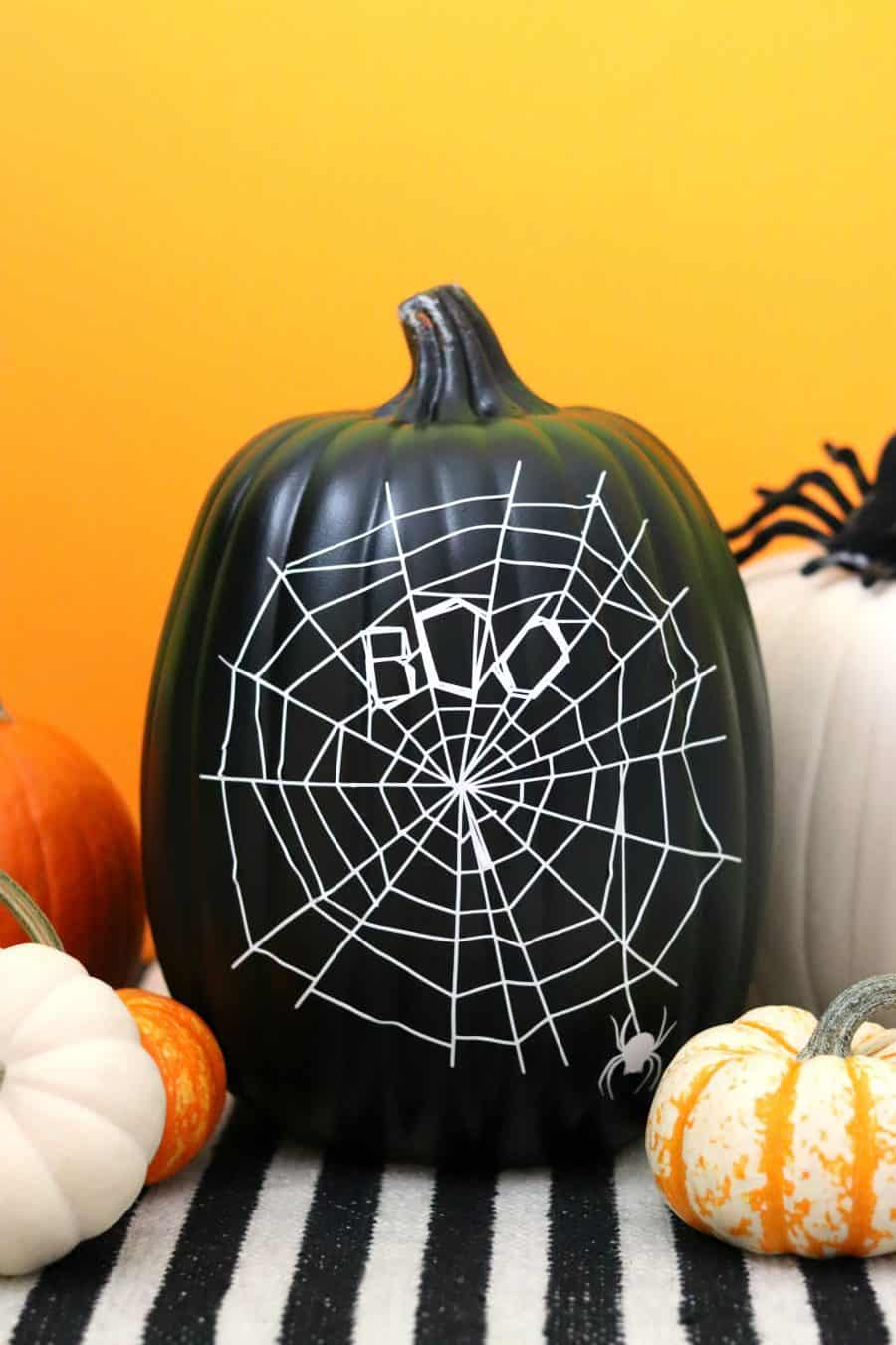 Halloween No-Carve Pumpkin with a spiderweb made with Vinyl