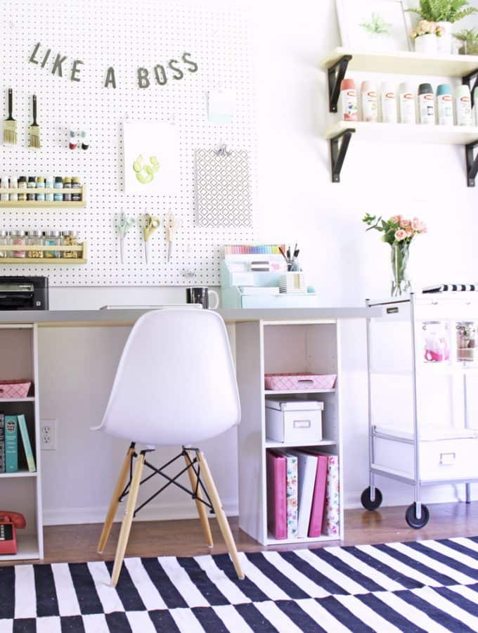 This craft room is organized so well and it's basically all IKEA! The desk is an IKEA hack, bookshelf for craft storage is from IKEA too!