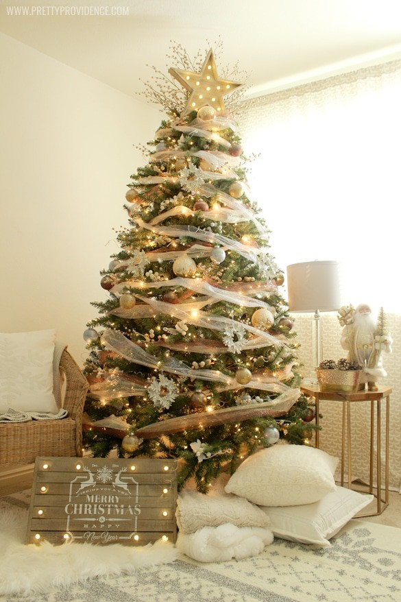 I am in love with this whimsical precious metals Christmas tree! Doesn't it just make you want to curl up with a blanket and watch lights dance for hours? Click through for how to's and more images!