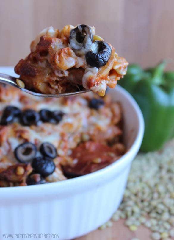 This rotini lentil pizza bake is both easy and delicious! Tastes like pizza but is packed with yummy lentils and veggies! Sure to trick even the pickiest of eaters!