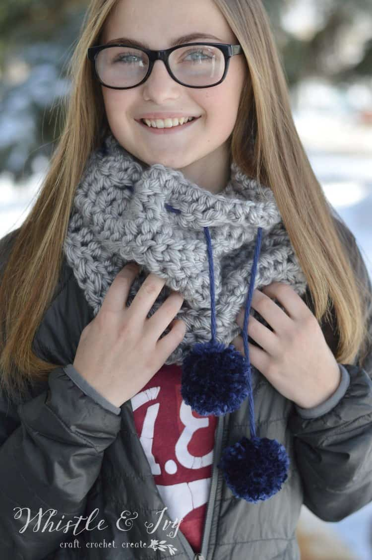 Quick and Easy Chunky Pom-Pom Cowl - Get the free and easy crochet pattern for this fab and cozy pom-pom cowl.