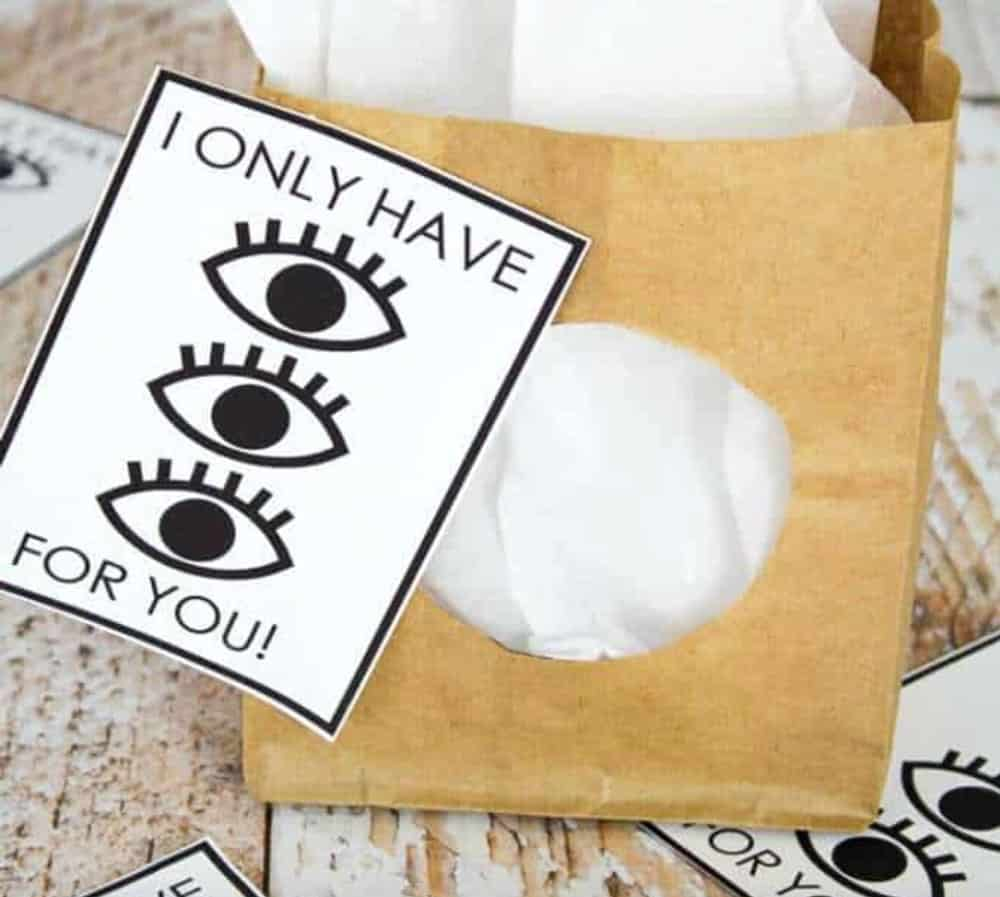 Brown gift bag with black and white punny Valentine attached 'I only have (image of three eyes) for you!'