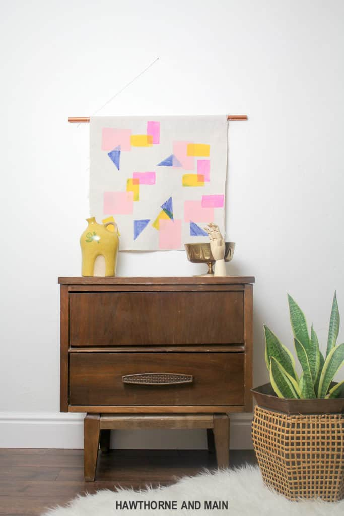 Check out how easy this color block wall art is to create. I think I could totally make this. Definitely pinning for later!