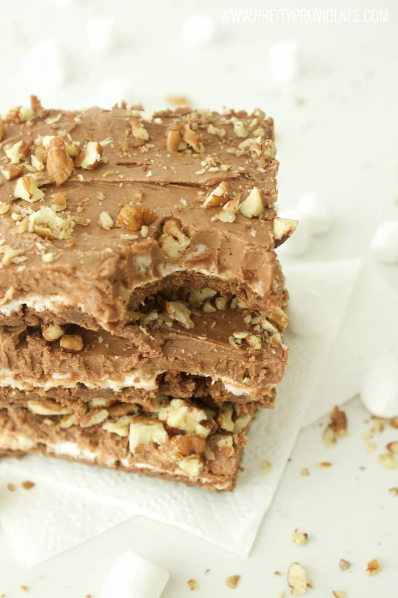 These rocky road brownies are to die for amazing! Literally SO easy to throw together, makes a ton, and always a crowd pleaser! You are gonna wanna pin these babies for sure!